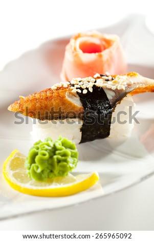 Japanese Cuisine -  Smoked Eel Nigiri Sushi with Ginger and Wasabi - stock photo