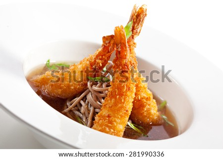 Japanese Cuisine - Soup with Deep Fried Shrimps and Noodles - stock photo