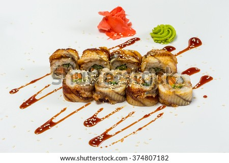 Japanese Cuisine - Sushi and Rolls with Seafood, Vegetables, Cream Cheese, isolated on a white background - stock photo