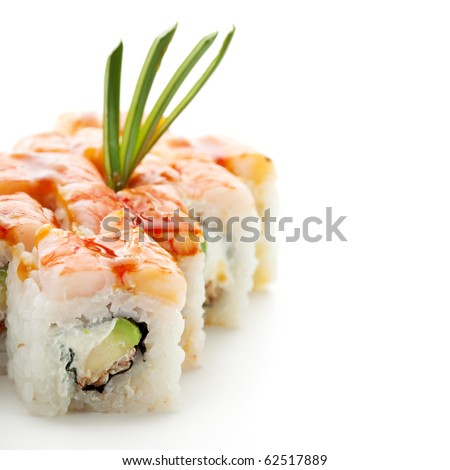 Japanese Cuisine - Sushi Roll with Avocado, Cream Cheese and Smoked Eel inside. Topped with Shrimp - stock photo