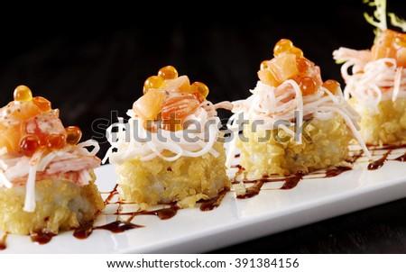 Japanese cuisine,Sushi roll with salmon and shrimp tempura  - stock photo
