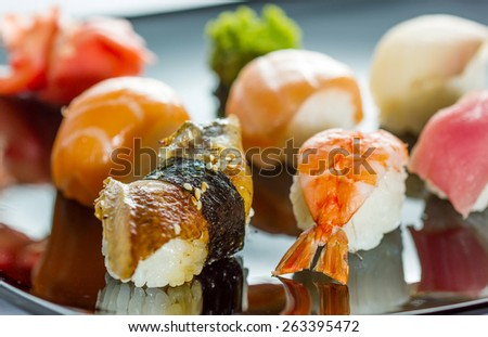 Japanese Cuisine - Sushi Set on black plate - stock photo