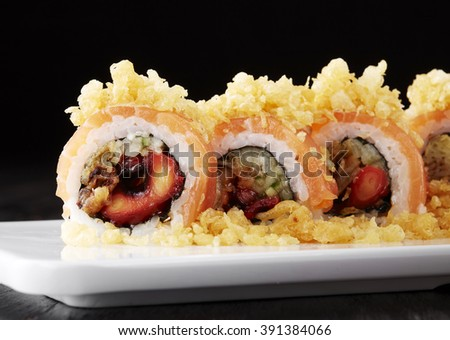 Japanese cuisine,Sushi set: sushi roll with salmon and sushi roll with smoked eel, selective focus. - stock photo