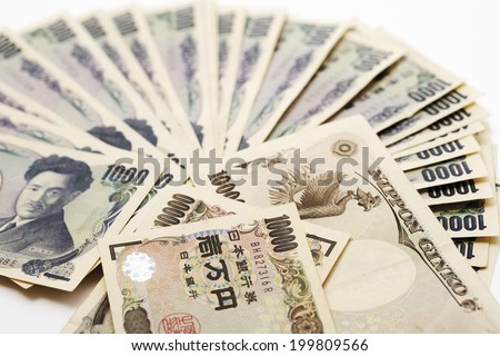 Japanese currency: one thousand yen banknotes - stock photo
