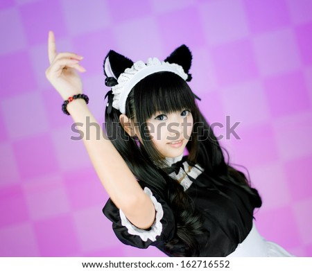japanese cute lolita maid in pink background click - stock photo