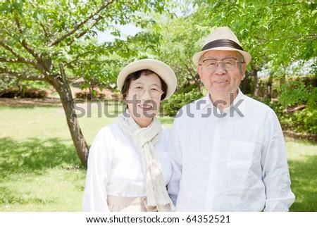 Japanese elderly couple smiling - stock photo