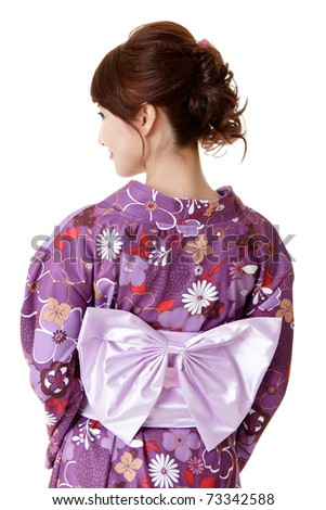 Japanese elegant woman in traditional clothes, kimono, closeup portrait of back view. - stock photo