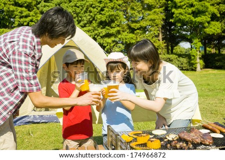 Japanese Family drinking the toast in the barbecue party
