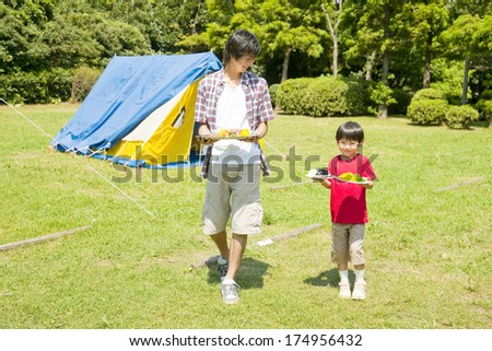 Japanese Father and son carrying food
