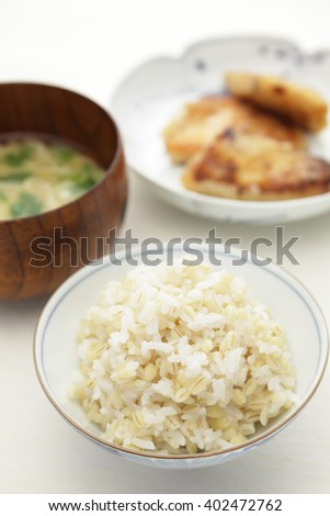 Japanese food, boiled naked barley and rice with miso soup and grilled fish  - stock photo