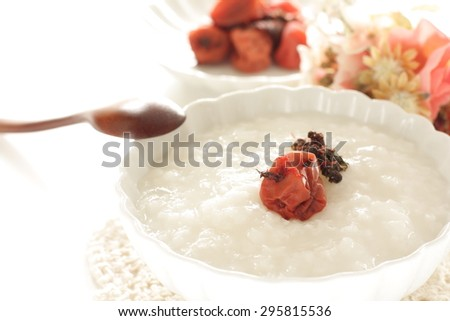 Japanese food, pickled Plum Umeboshi and congee - stock photo