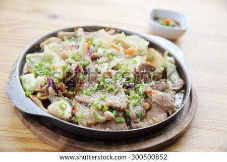 Japanese food pork with ginger on pan in wood background