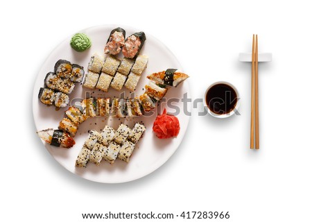 Japanese food restaurant, unagi sushi maki gunkan roll plate or platter set. Set for two with chopsticks, ginger, soy, wasabi. Sushi isolated at white background. Top view, flat lay. - stock photo