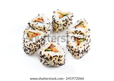 Japanese food. Roll with salmon, cucumber and sesame. Eight pieces, over white. Selective focus. - stock photo