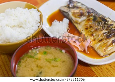 Japanese food, Saba in teriyaki sauce with salad and rice - stock photo