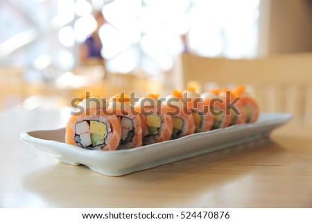 Japanese food Salmon roll on wood background