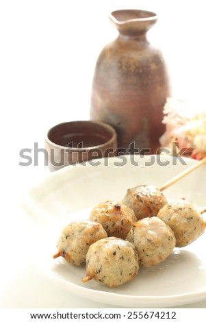 Japanese food, Tsukune Yakitori and Sake - stock photo