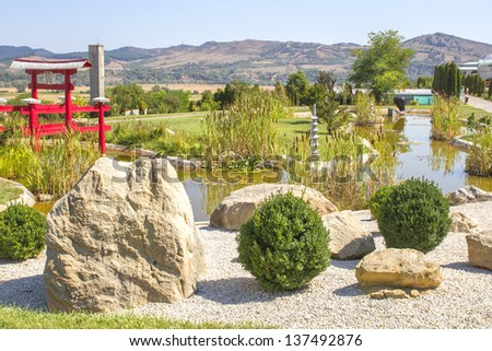 Japanese garden in sunlight - stock photo