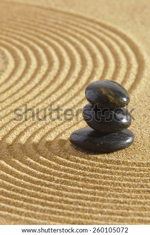 Japanese garden with stone in sand