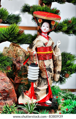 Japanese geisha doll on the white  background