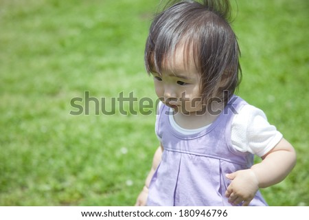 Japanese girl playing in the park,