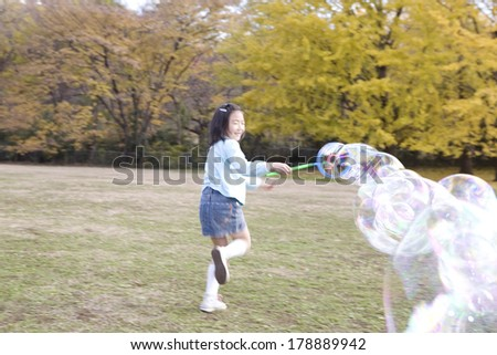 Japanese girl playing with the bubble