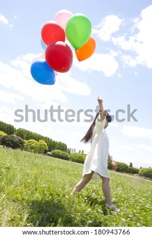 Japanese girl running with a balloon
