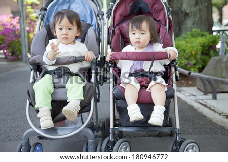 Japanese girl taking a walk on her stroller, - stock photo