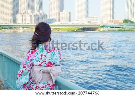 "Japanese girl wearing a casual summer kimono called ""Yukata"". - stock photo"
