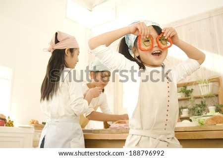 Japanese girls cooking in kitchen - stock photo