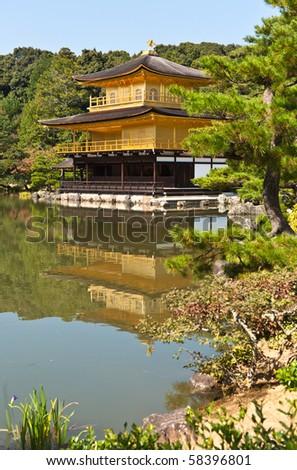 Japanese golden pagoda and  water reflex - stock photo