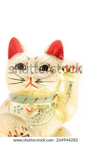 Japanese gorgeous golden beckoning cat also known as a Maneki Neko raising her left paw - stock photo