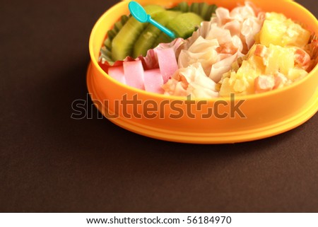 Japanese homemade packed lunch isolated on brown background