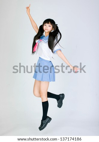 japanese jumping student girl - stock photo