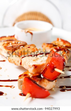 Japanese kebabs with salmon. Traditional Oriental food. Tasty and nutritious. Beautifully decorated - stock photo