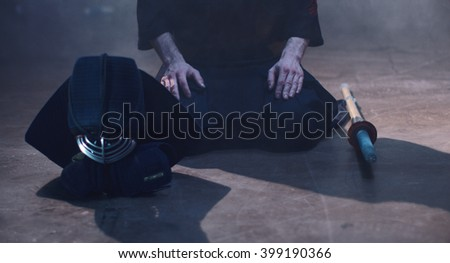 Japanese Kendo. The fighter sits in Kendo armor in the fog. - stock photo