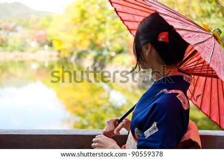 japanese kimono woman with traditional red umbrella
