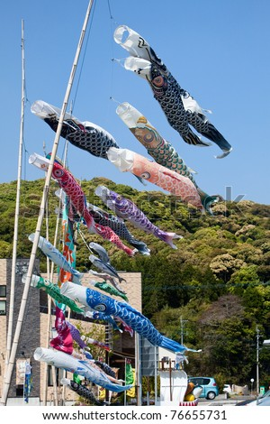 Japanese koi carp wind socks blow in the wind. In Japan these are flown by the families of male children in the weeks before and after the May 5th Children's Day holiday. - stock photo