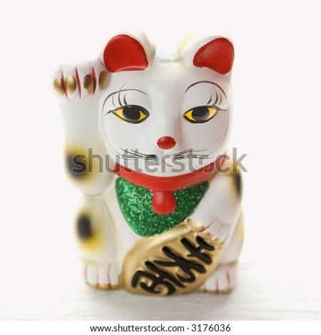 Japanese lucky cat figurine. - stock photo