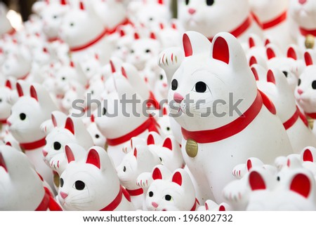 Japanese Lucky Cat Statues at a Temple in Tokyo - stock photo