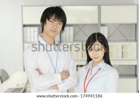 Japanese Man and Woman laughing in the office