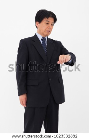 Japanese man wearing a suit