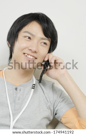 Japanese Man who have conversation with mobile phone - stock photo