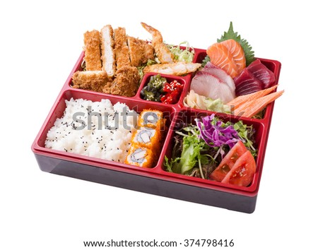 Japanese Meal in a Box (Bento) isolated on white background - classic salad, breaded shrimp and zucchini, sushi and rolls (clipping path) - stock photo