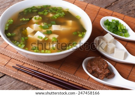 Japanese miso soup and ingredients on the table close-up. horizontal  - stock photo