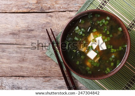 Japanese miso soup with tofu on the table. top view of a horizontal  - stock photo
