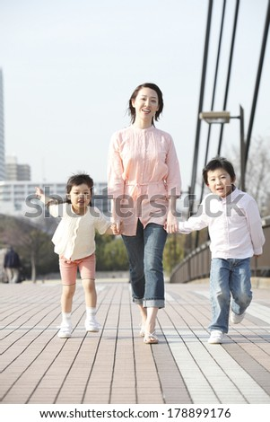 Japanese mother and children walking on the overpass