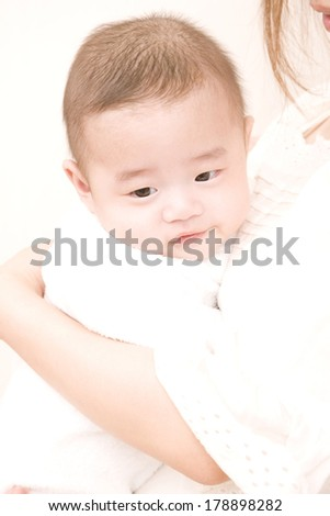 Japanese mother hugging baby