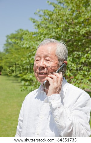 Japanese old man talking on mobile phones - stock photo