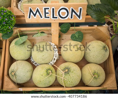 Japanese organic green melons in the fruit crate with melon label. - stock photo